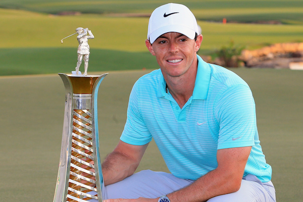 Rory McIlroy of Northern Ireland holds the Race to Dubai trophy at the DP World Golf Championship in Dubai