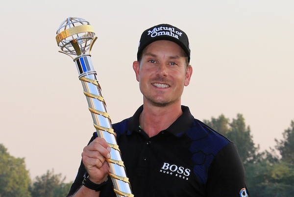 Henrik Stenson from Sweden holds the trophy of the DP World Golf Championship